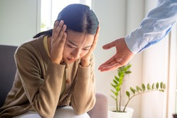 Female patients with mental and physical illnesses and psychiatrists. The psychiatrist is encouraging and is ready to help, preparing for the treatment of mental symptoms and depression.