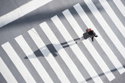 Female pedestrian walking on the zebra.