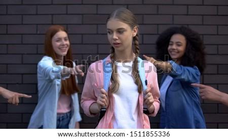 Female peers pointing fingers desperate schoolgirl, college teasing condemnation #1511855336