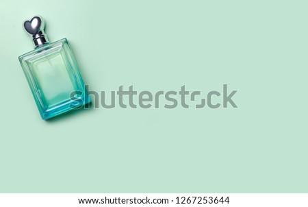 Female perfume beauty on a green background #1267253644