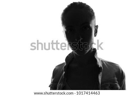 Female person silhouette,back lit light #1017414463