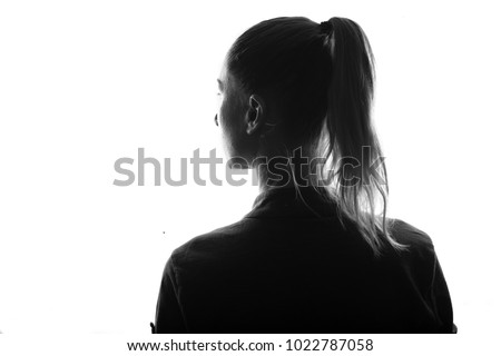 Female person silhouette,view from behind,back lit over white