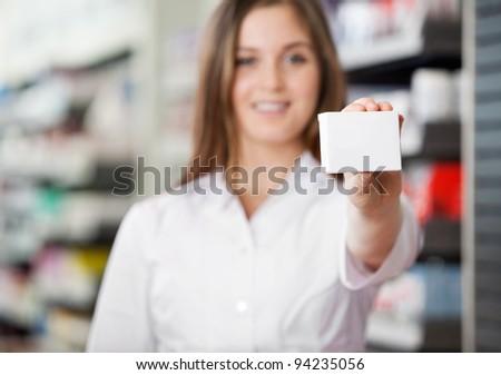 Female pharmacist advising to prefer prescribed medicine