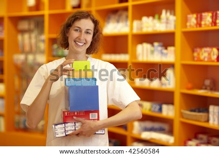 Female pharmacist carrying medicine in her hands