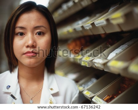Female pharmacist with medical supplies