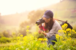 Female photographer at flower field