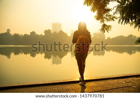 Female photographer.Female photographer photographed in the morning. Travel