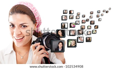 Female photographer holding the camera - isolated over a white background