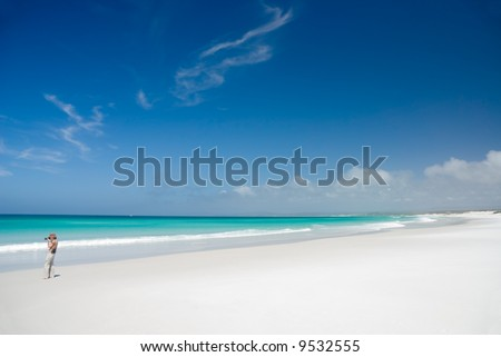 Female Photographer on Perfect White Beach on the Bay of Fires in Mount William National Park, Tasmania, Australia