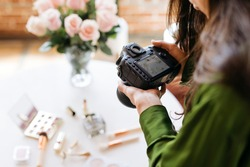 Female photographer shooting beauty products on the table