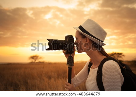 Female photographer shooting in a beautiful outdoor setting.