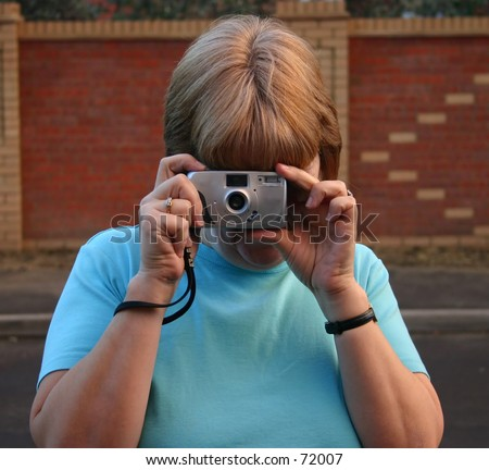 Female Photographer with point and shoot camera