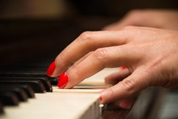Female pianist hands closeup and piano keyboard