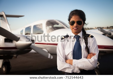 Female Pilot Standing in Front of Aircraft