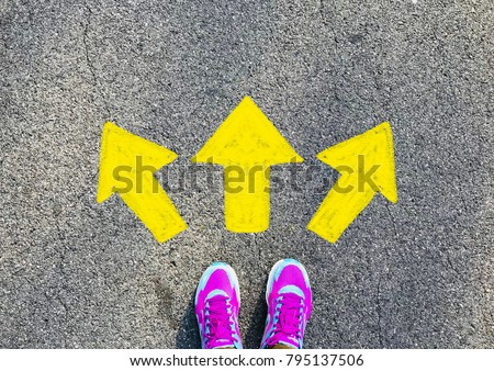 Female pink sport shoe with yellow drawn direction  arrow as guidance, top view. Young street lifestyle, which way your choice #795137506