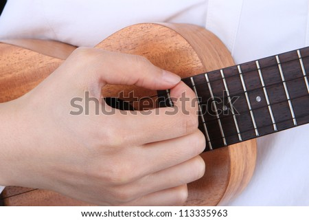 female playing Ukulele