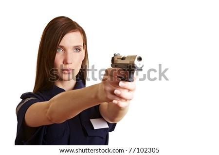 Female policer officer aiming her service weapon