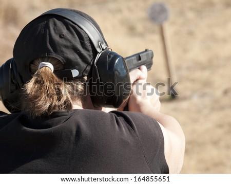 Female practicing target shooting.