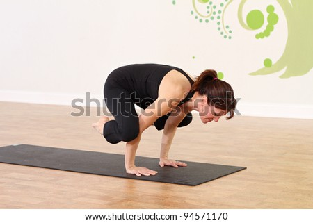 Female practicing yoga in a studio setting