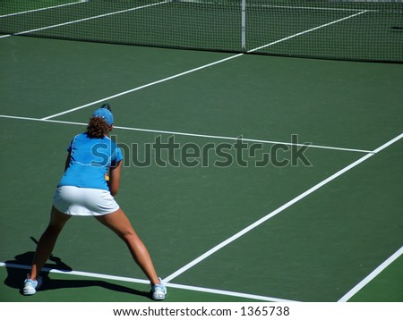 Female preparing to return a serve