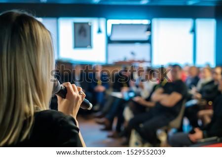 Female presenter speaks to audiences at workshop
