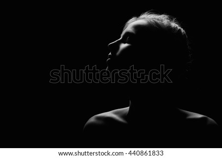 female profile on black background monochrome image with copyspace #440861833