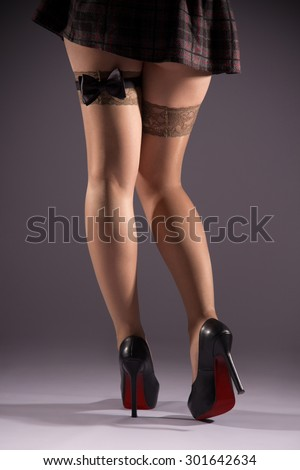 Female prostitution, violation of the law, bow tie on his hip, immorality youth, feet in nylon stockings.