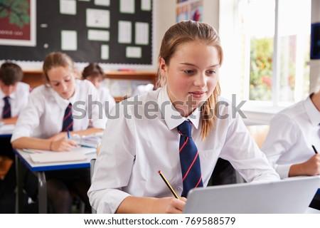 female pupil wearing uniform...