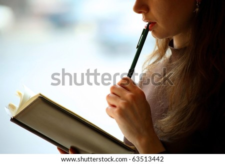 Female reading a book, closeup, background