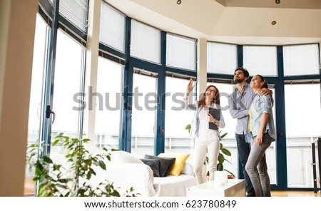 Female Real Estate agent offer home ownership to young couple. #623780849
