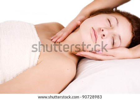 Female receiving massage therapy on neck
