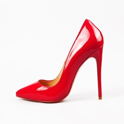 female red high-heeled shoes over white