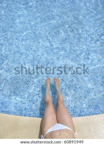 female refreshing in the hotel pool