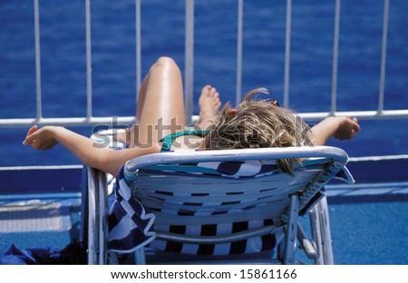 Female relaxing on a cruise ship while on vacation.