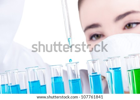 Female researcher with test tubes in laboratory - stock photo
