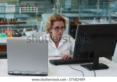 Female researchers working on computers in a laboratory.