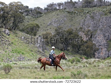 female rider with horse in the outback