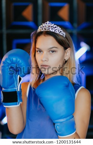 Female rivalry.Woman with gold crown on her head and in a boxing gloves.Sport. Competition. #1200131644