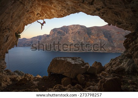 Female rock climber on a cliff in a cave at Kalymnos, Greece