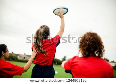 Female rugby player throwing a ball