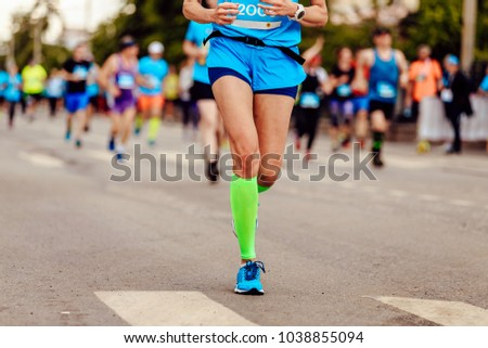 female runner athlete run ahead of group runners #1038855094