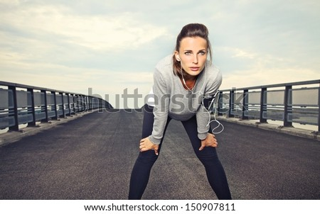 Female runner with focus and determination to run