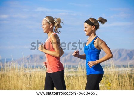 Female Runners on a jog outdoors (side view)