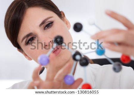 Female Scientist Concentrating On Molecular Structure In Laboratory