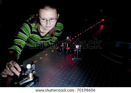 female scientist using lasers while doing research in a quantum optics lab