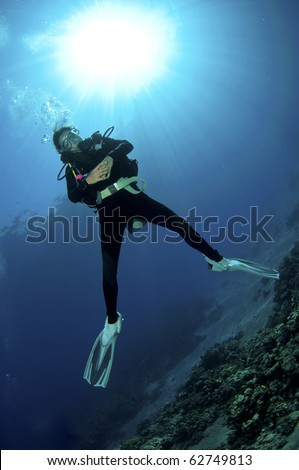 female scuba diver enjoys a dive in the red sea