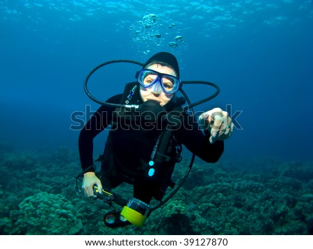 Female Scuba Diver swimming over a Reef in Kona Hawaii