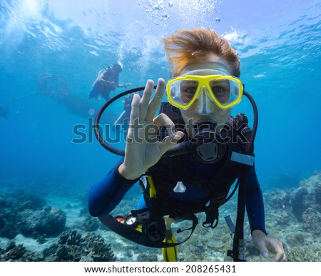 Female scuba diver underwater showing ok signal #208265431