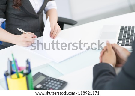Female secretary being ready to write down after her boss