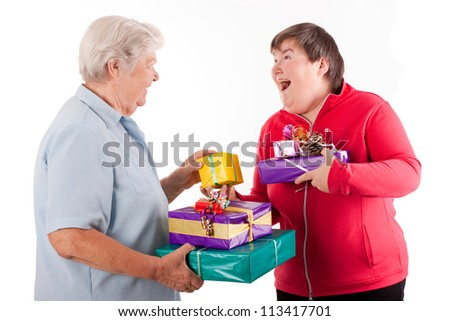 female senior and mental disabled woman holding presents